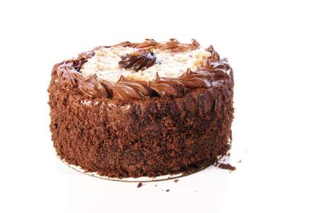 ドイツのチョコレート ケーキ。二重層のチョコレートのアイシングとココナッツの釉薬とラウンド。