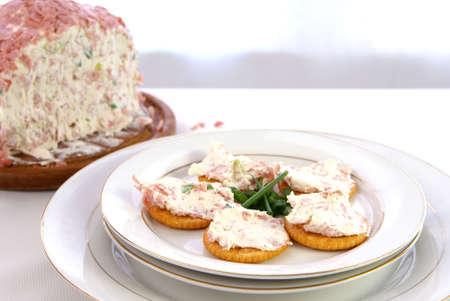 Cheeseball spread on crackers with green onion garnish Stock Photo
