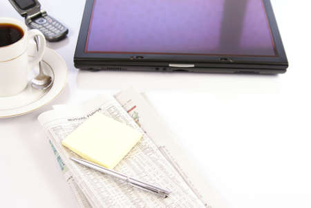 Office desk with tablet computer, newspapers, coffee and phone Stock Photo - 2391923