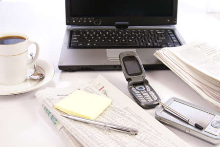 Office desk with laptop computer, newspapers, coffee and misc work materials Stock Photo - 2391948