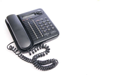 Office telephone isolated on white Фото со стока