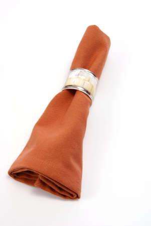 napkin ring: Cloth napkin with decorative napkin ring. On white