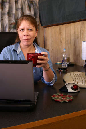 Woman working in home office with laptop and coffee in retro style decor Stock Photo - 2390655