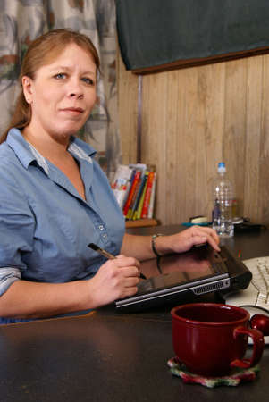Woman working with tablet pc in home office Stock Photo - 2390664