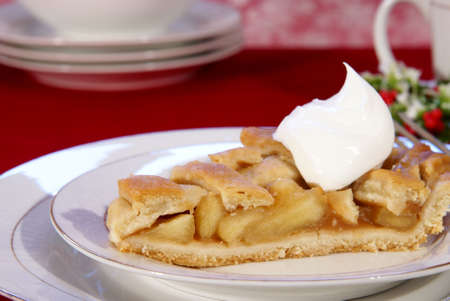 Slice of apple pie with lattice crust, dollop of whipped cream, and coffee. Stock Photo