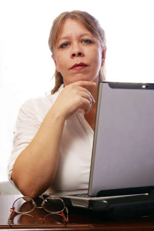 Woman in white blouse working on laptop computer Stock Photo - 2458086