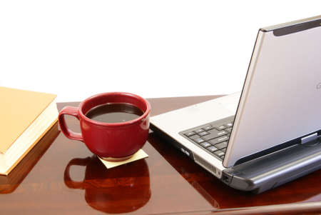 Wood desk with laptop computer, coffee, and book. Stock Photo