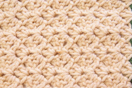 Close up of crochet pattern texture for use as background or design elements.
