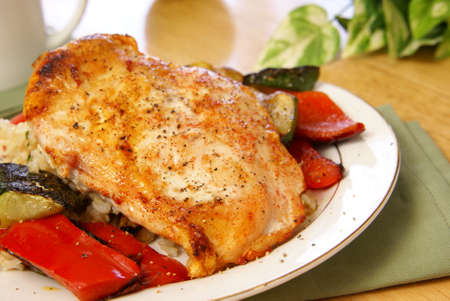 Broiled chicken with cayenne and cracked black pepper, served with zucchini, red bell peppers, and wild brown rice.