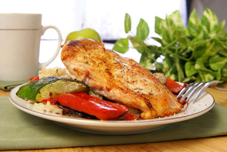 Broiled chicken breast with cayenne and cracked black pepper, served with zucchini, red bell peppers, and wild brown rice.