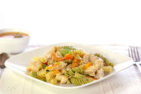 Colorful fresh pasta salad with chicken breast and fresh garden vegetables.