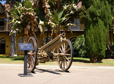 plaque: Antique military cannon with plaque.