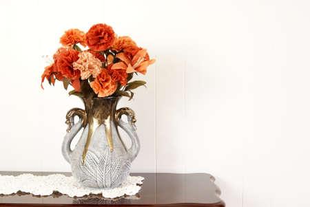 Silk flower arrangement in vase.