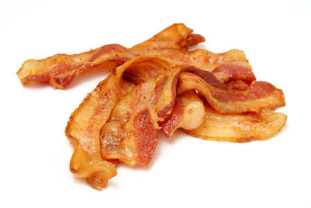 sizzle: Sizzling Bacon. Fresh cooked bacon over white