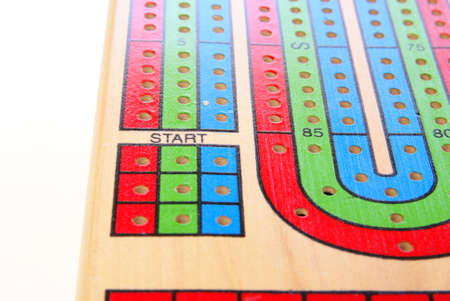 Focus on the word Start on a retro cribbage game board