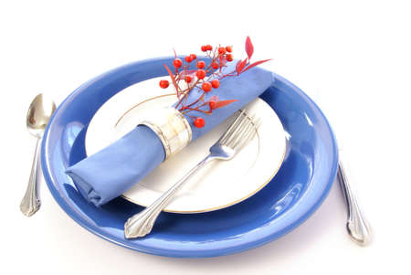 Elegant table setting in blue and white, with fresh sprigs of leaves and berries Stok Fotoğraf