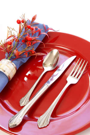 Elegant table setting in red and blue, with fresh sprigs of leaves and berries Stock Photo - 2753347