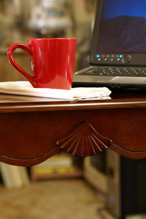 Cup of coffee on desk next to laptop computer Stock Photo - 2753278