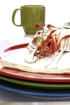 Colorful tableware plates and cups in red, blue, and green. Stock Photo - 2784225