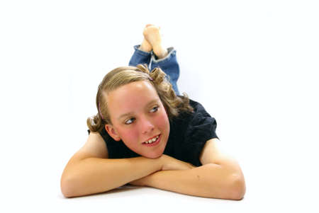 Happy young woman laying on the floor with feet in the air