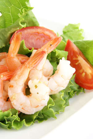 Shrimp salad. Jumbo shrimp with tails, lettuce, tomato and light dressing. Stock Photo