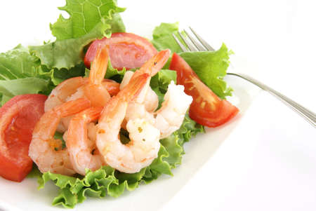 jumbo shrimp: Shrimp salad. Jumbo shrimp with tails, lettuce, tomato and light dressing. Stock Photo