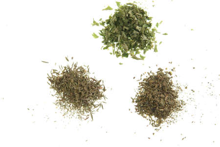 Dried Herbs. Parsley, Thyme, and Basil on white