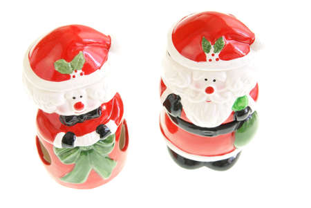 mrs: Santa and Mrs Claus figurines on white