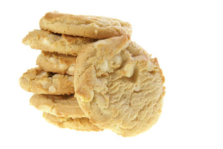 Stack of white chocolate macadamia nut cookies on a white background.