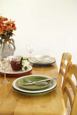Dinner table setting with green and white plates on a wooden table Stock Photo - 4317984