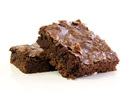 Two chewy chocolate fudge brownie squares on a white background