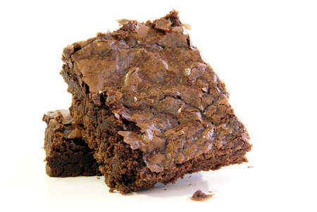 Fresly baked chocolate fudge brownie squares on a white background Stock Photo