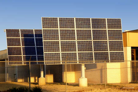 Large solar panel array in early morning sunlight Stock Photo