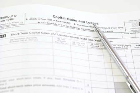 capital gains: Capital gains and losses, schedule D, U.S. tax forms Stock Photo