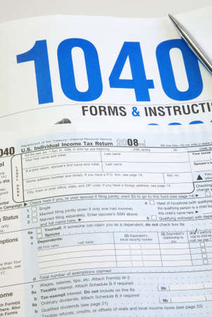 Tax Time concept. Form 1040 laying on top of instruction packet