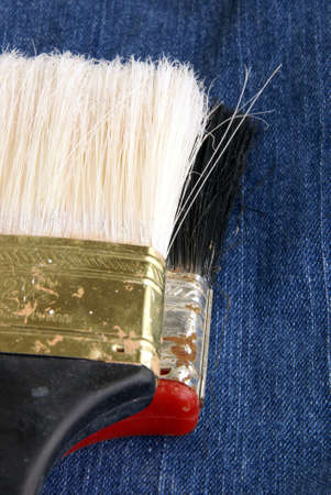 Two old paintbrush heads with dried paint on them. Stock Photo - 5022262