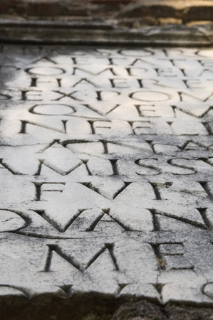 Close-up of Roman Age tombstone inscription on the Appian Way (Appia Antica), Rome, Italy, Europe. Shallow DOF. Stock Photo - 12160811