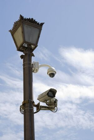 pio: Detail of street light with security cameras against sky. Piazza Pio XII, opposite to St Peters basilica, Vatican. Stock Photo
