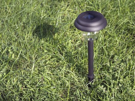 Close-up of solar powered garden light. photo