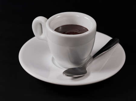 hot chocolate in a Cup on a black background