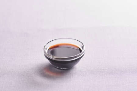 soy sauce with a bowl on the table
