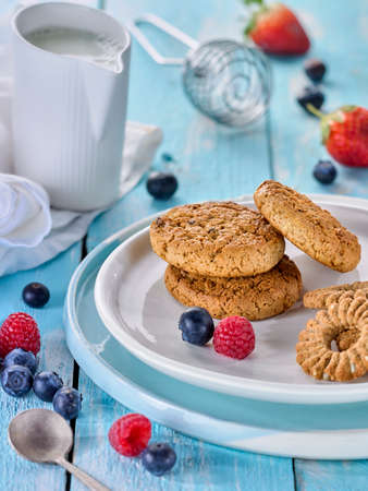 oatmeal cookies with berries on a blue background