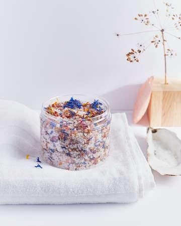 bath salt with flowers on a light background