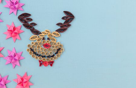 Christmas quiling decoration elements on blue board for background composition Stock Photo
