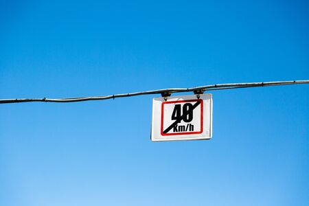 law of portugal: Speed limit hanged tram sign over train track