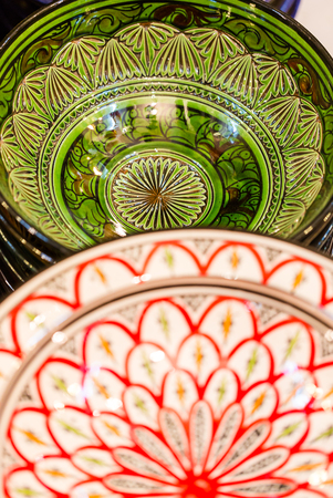 Handmade and painted colorful traditional plates on medina souk in Marrakesh