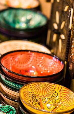 Handmade and painted colorful traditional plates and pots on medina souk in Marrakesh