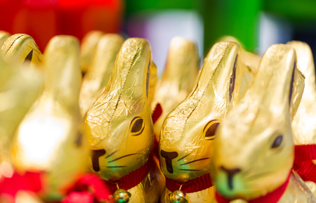 Easter bunny Lindt chocolate on shelves in supermarket for sale wrapped in golden foil. Lindt & Sprüngli  produces the highest quality premium chocolate in high ethical and sustainability standards. 13 March 2017.