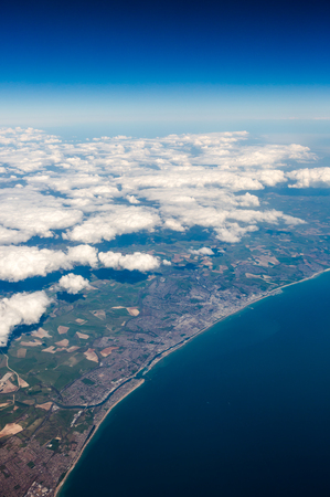 brighton: UK south cost cliffs view from top on Eastbourne, Brighton, English border, English Channel in sunny clear sky weather. Vertical full frame crop Stock Photo