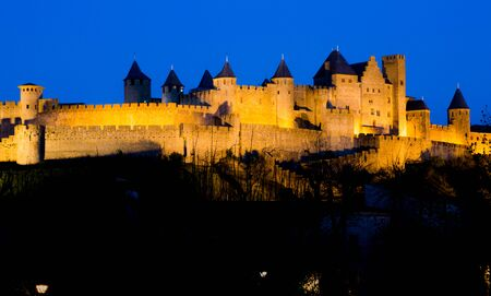 Medieval village Carsassonne in France night view with illuminated wall. Horizontal full frame orientation